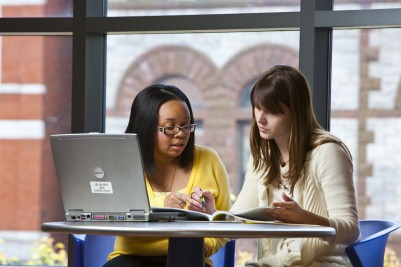 Online Advanced Graduate Business Certificate in Accounting Analytics: Students Sitting at Table